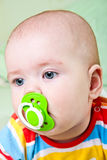 Baby girl with pacifier. Stock Images