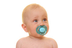Baby girl with pacifier Stock Image