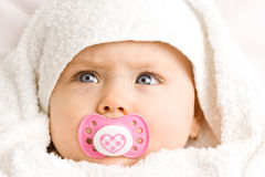 Baby girl with pacifier Stock Photos
