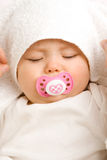 Baby girl with pacifier stock photo