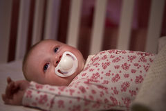 Baby Girl With Pacifier Lying In Cot Royalty Free Stock Photo