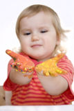 Baby girl with paint on hands. Baby girl with fingerpaint on hands, focus on hands royalty free stock image