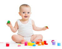 Baby girl with paints Royalty Free Stock Photo