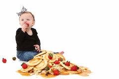 Baby Girl with Pancakes Royalty Free Stock Photo