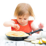 Baby girl with pancakes Royalty Free Stock Photography