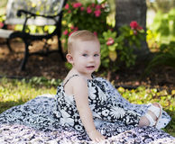 Baby girl in park royalty free stock photos