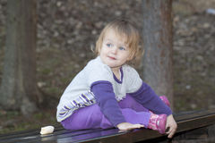 Baby girl in a park Stock Photography