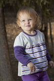 Baby girl in a park Stock Image