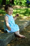 Baby girl in park Stock Image