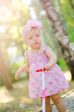 Baby girl in park. Little cute girl walks in a sunny birch park royalty free stock photography