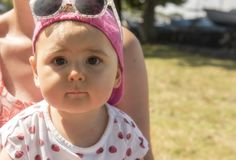 Baby girl in park on a sunny day. Outdoors stock photos