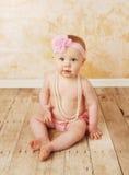 baby girl pearls wearing Arkivfoto