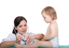 Baby girl with pediatrician Royalty Free Stock Images