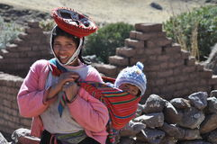 Baby and girl from Peru Stock Photos