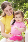 Baby girl with phone receiver Royalty Free Stock Photography