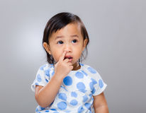 Baby girl pick nose Royalty Free Stock Photos