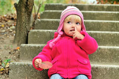 Baby girl picking her nose Royalty Free Stock Photos