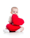 Kid girl with pillow in heart shape Royalty Free Stock Photos