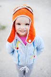 Baby girl in pilot hat smiling at the camera. Dream of flying Royalty Free Stock Images