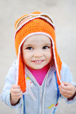 Baby girl in pilot hat smiling at the camera. Dream of flying Stock Image