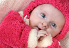 Baby girl in pink. Little baby girl in pink smiling Royalty Free Stock Photography
