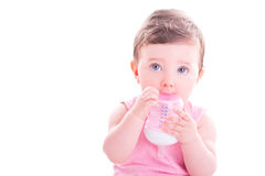 Baby girl with pink baby bottle. Beautiful baby girl with pink baby bottle Stock Photo