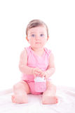 Baby girl with pink baby bottle. Royalty Free Stock Photography