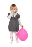 Baby girl with pink balloon Stock Image