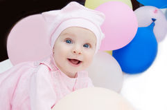 Baby girl in pink with balloons royalty free stock image