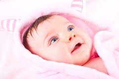 Baby girl in pink bathrobe. Royalty Free Stock Photos