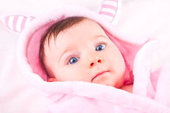 Baby girl in pink bathrobe. Royalty Free Stock Images