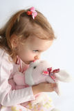 Baby girl and pink bunny Royalty Free Stock Photos