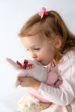 Baby girl and pink bunny Royalty Free Stock Image