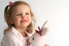 Baby girl and pink bunny Stock Images