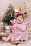 Baby girl with pink butterfly wings Royalty Free Stock Images