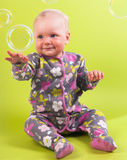 Baby girl with pink capitium and soap bubble Royalty Free Stock Images