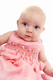 Baby girl in pink dress Stock Images