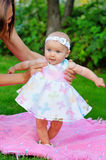 Baby girl in a pink dress Stock Images
