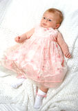 Baby girl in pink dress Stock Photo