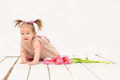 Baby girl in pink dress with flowers Royalty Free Stock Photos