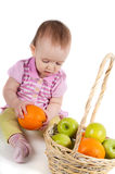 Baby girl in pink and fruits Stock Image