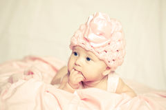 Baby girl in a pink hat Stock Images