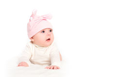 Baby girl in a pink hat with rabbit ears isolated on white royalty free stock images