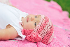 Baby girl in pink knitted hat Royalty Free Stock Image