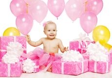 Baby Girl with Pink Present Gift Boxes, Kid Celebrating Birthday Stock Photography