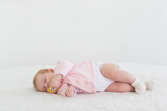 Baby girl in a pink sleeping. Beautiful baby girl in a pink sleeping sweet dream Royalty Free Stock Photos