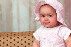 Baby girl in pink suit and hat Stock Photo
