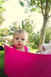Baby Girl in Pink Tub. A one year old girl looking serious in a pink plastic tub Stock Photos