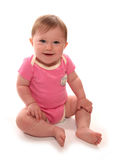 Baby girl in pink vest sitting. Cutout Stock Photos