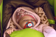 Baby girl in pink warm clothes Royalty Free Stock Photo